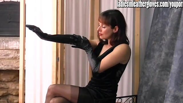 Leggy british mature with a leather glove fetish