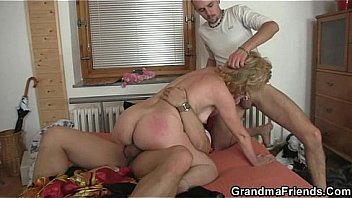 Lonely granny spreads her legs