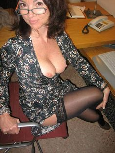Business woman in stockings facesitting