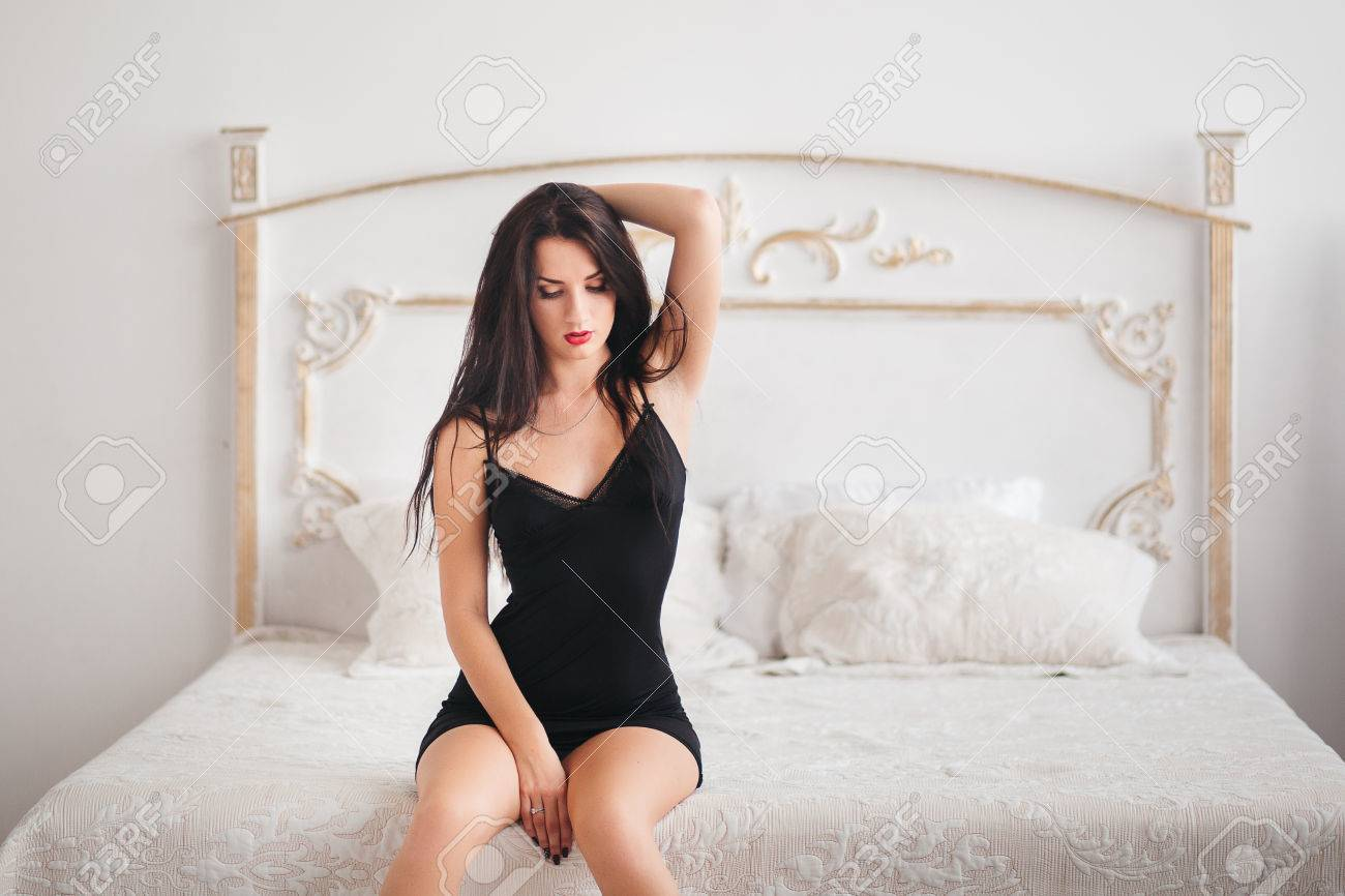 Sexy brunette in bed